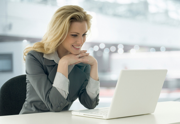 Image of young woman looking at laptop