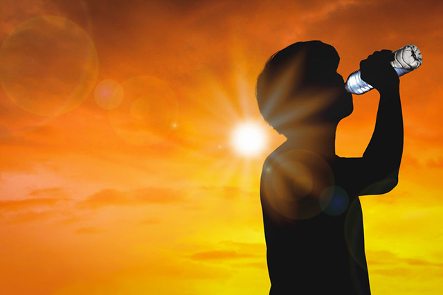 graphic showing person drinking from clear bottle in blazing sunshine