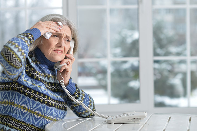 Image of  unwell older patient calling GP surgery for remote total triage service.